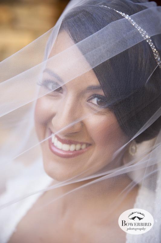 The bride peeks from behind her veil. Wedding photos at Meritage Resort & Spa. © Bowerbird Photography 2014