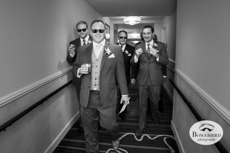 The groomsmen leave the hotel room. Meritage wedding in Napa Valley.© Bowerbird Photography 2014