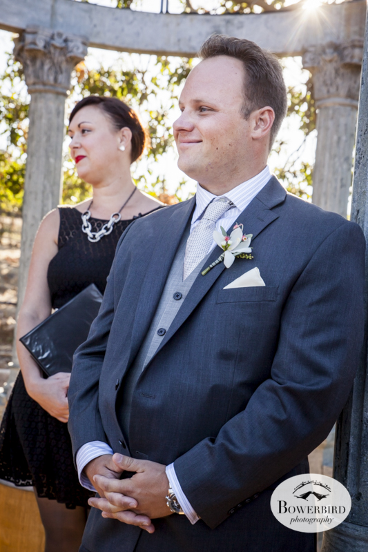 The groom waits for his bride to appear. Wedding ceremony at Meritage Resort & Spa.  © Bowerbird Photography 2014