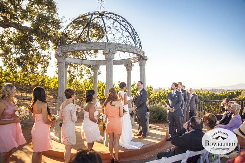 Their beautiful wedding ceremony site at the Meritage in Napa, features a Romanesque marble pergola with the vineyards in the background.  © Bowerbird Photography 2014