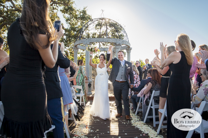They are married! Love this photo showing their triumphant walk down the aisle after their wedding ceremony at the Meritage Resort and Spa.© Bowerbird Photography 2014