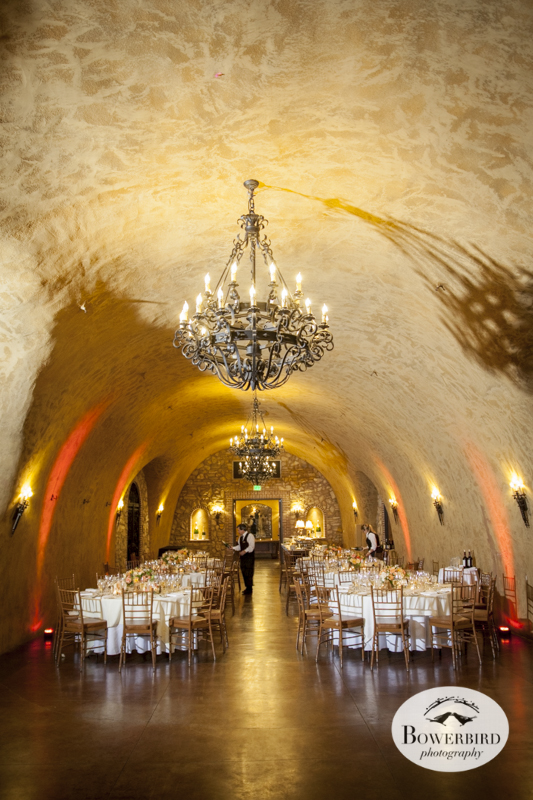 The wedding reception looks beautiful in the Meritage wine cave in Napa Valley. © Bowerbird Photography 2014