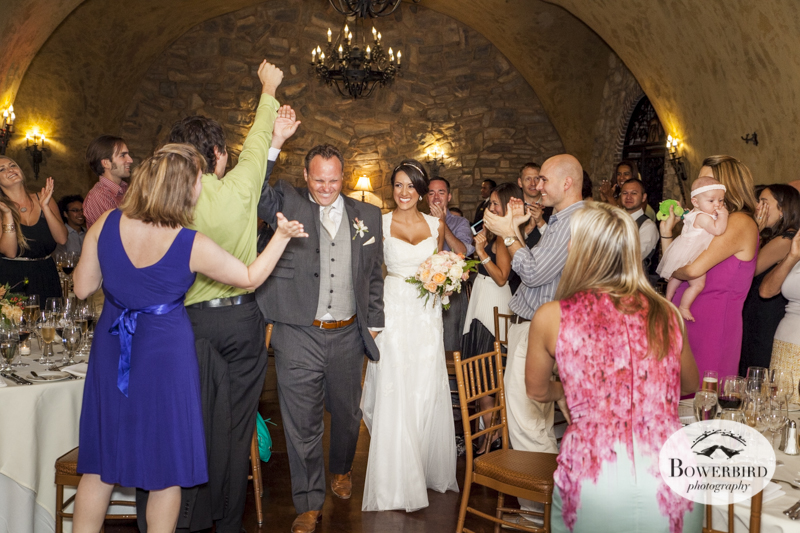 Wedding guests greet the newlweds at the Meritage wine cave during the reception.© Bowerbird Photography 2014