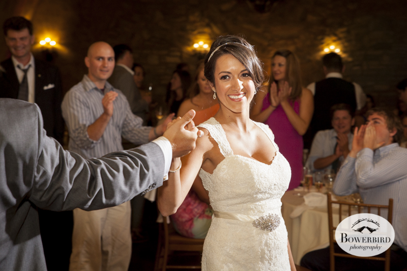 The bride shows off her moves during the first dance. Meritage resort and spa wedding reception in tasting room. © Bowerbird Photography 2014