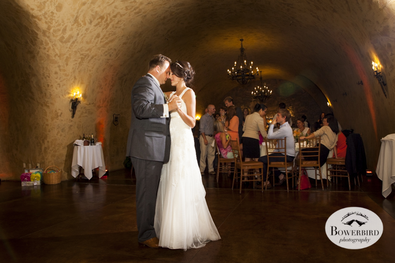 Sharing a tender moment during the first dance. Meritage resort and spa wedding reception in tasting room. © Bowerbird Photography 2014