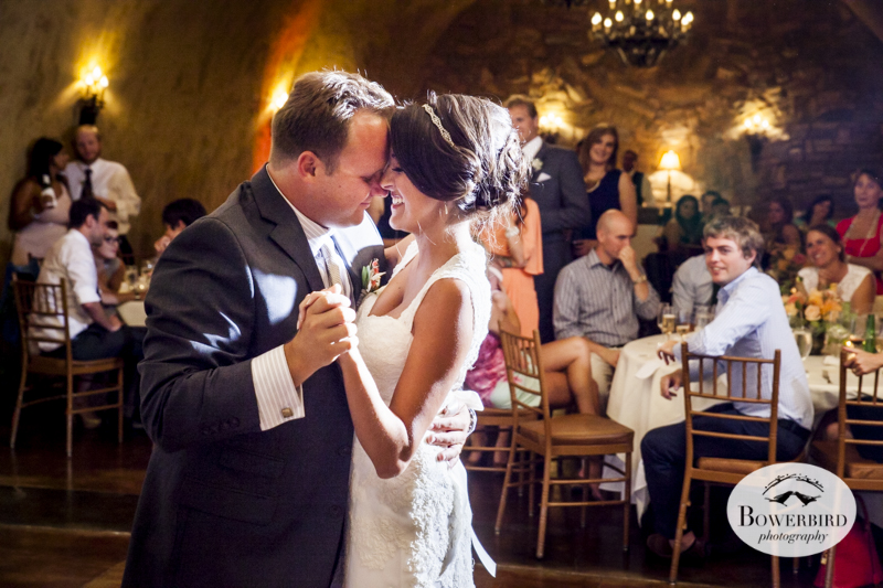 The bride and groom enjoy their first dance. Meritage resort and spa wedding reception in tasting room. © Bowerbird Photography 2014