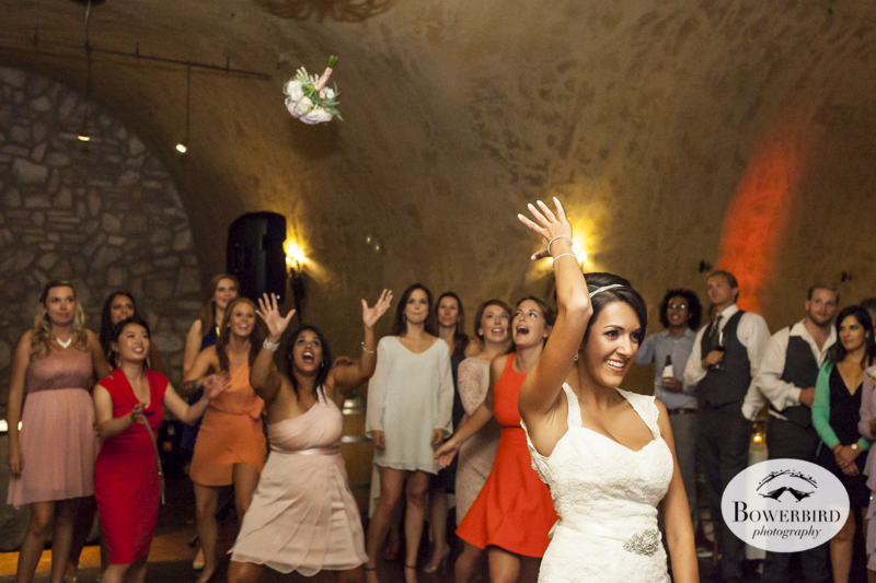 Bouquet toss. Meritage resort and spa wedding reception in tasting room. © Bowerbird Photography 2014