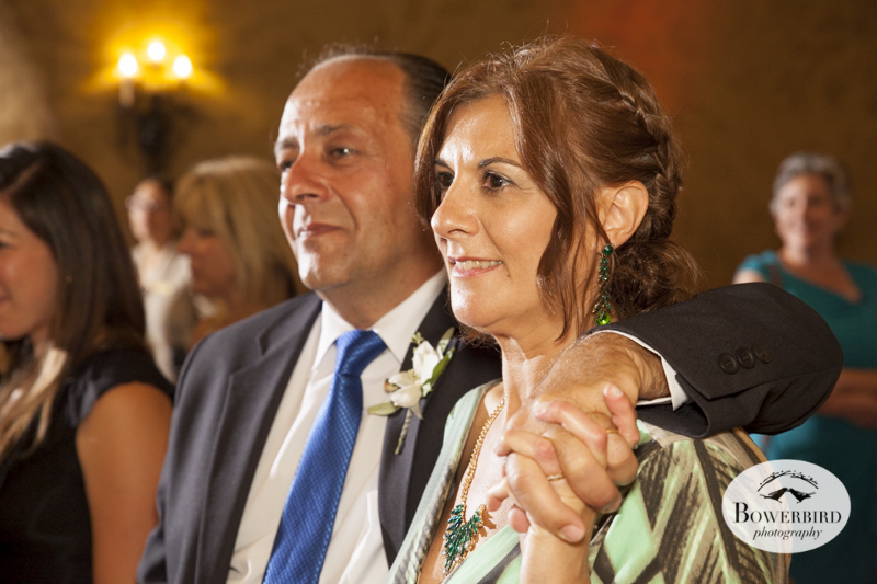 The bride's mom and dad look on.Meritage resort and spa wedding reception in tasting room. © Bowerbird Photography 2014