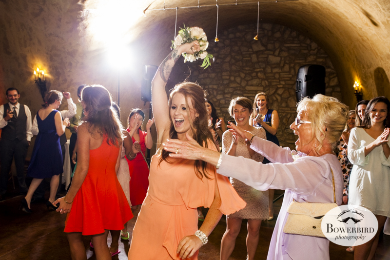 The groom's sister catches the bouquet and Mom is ecstatic!Meritage resort and spa wedding reception in tasting room. © Bowerbird Photography 2014