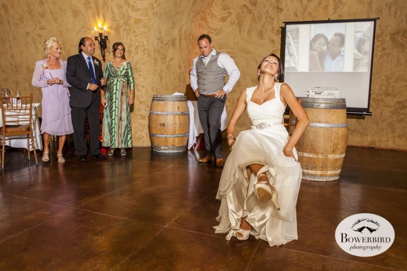 The groom prepares to get the bride's garter! © Bowerbird Photography 2014