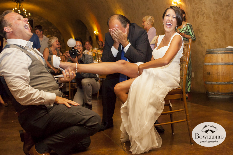 The bride's father can't believe she's showing off her legs!Meritage resort and spa wedding reception in tasting room. © Bowerbird Photography 2014
