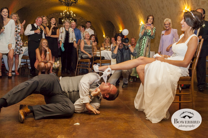 The groom takes off the bride's garter using his teeth! Meritage resort and spa wedding reception in wine cave. © Bowerbird Photography 2014