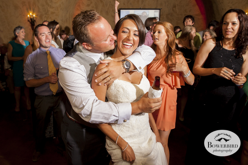 The groom embraces his wife on the dance floor.Meritage resort and spa wedding reception in wine cave. © Bowerbird Photography 2014