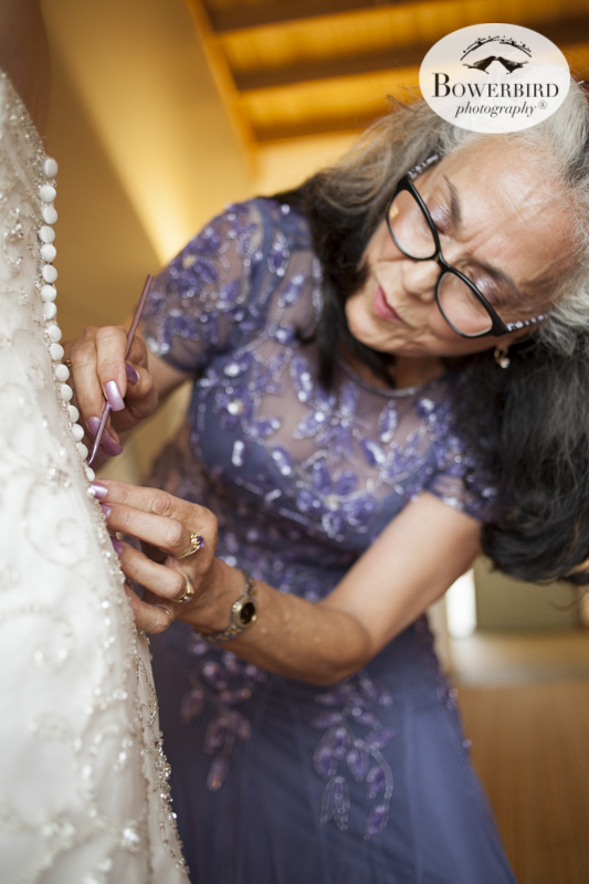 Putting on wedding dress at Cavallo Point Lodge. © Bowerbird Photography 2015