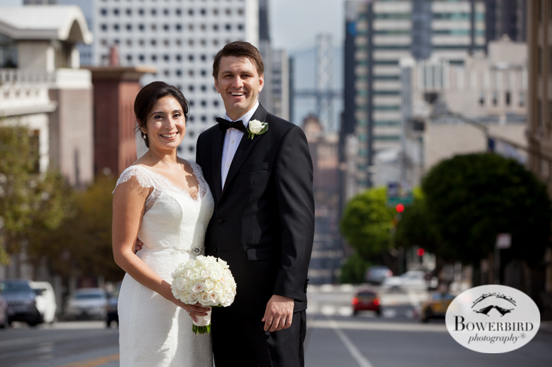 Fairmont Hotel Wedding in San Francisco. The bride and groom at the top of Nob Hill with a view of downtown San Francisco behind them. © Bowerbird Photography 2016