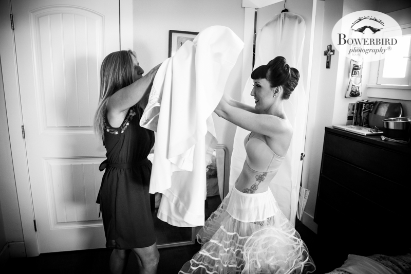 Los Angeles Destination Wedding Photography. The bride and her mom putting on her wedding dress. © Bowerbird Photography 2016