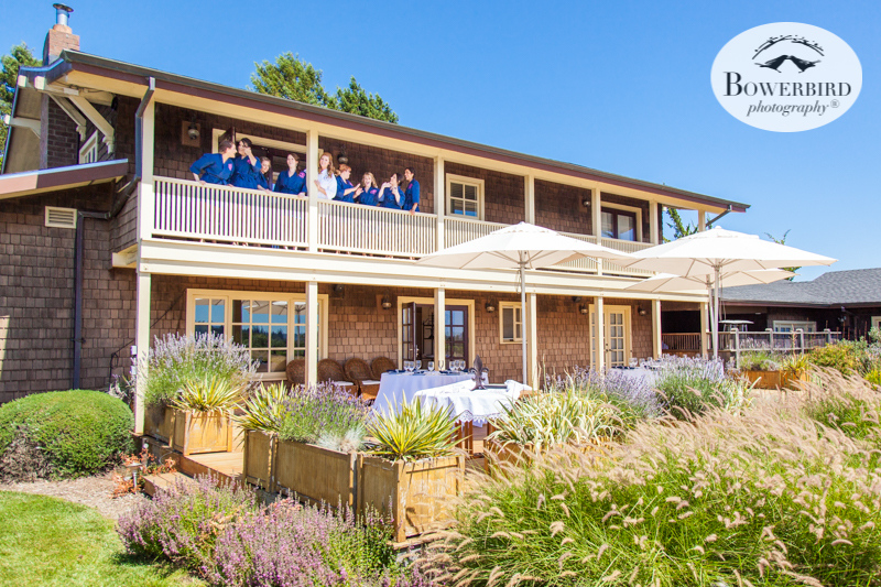 Bridemaids get prepared on the balcony in matching blue robes.DeLoach Vineyards. Sonoma Wedding Photographer. © Bowerbird Photography 2016