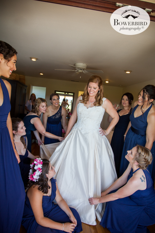 The girls admire the bride as she gets dressed on her big day at DeLoach Vineyards. Sonoma Wedding Photographer. © Bowerbird Photography 2016