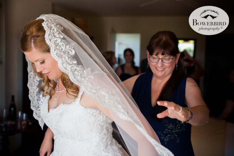 Mom adds her final touches, putting on the veil at DeLoach Vineyards. Sonoma Wedding Photographer. © Bowerbird Photography 2016