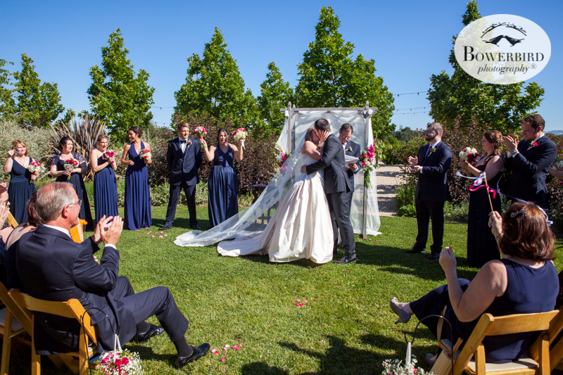 """The guests shout, """"Wooooot!"""" as the bride and groom have their first kiss.DeLoach Vineyards. Sonoma Wedding Photographer. © Bowerbird Photography 2016"""