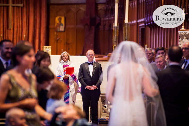 Grace Cathedral, SF. The groom sees his bride for the first time down the aisle. © Bowerbird Photography 2016