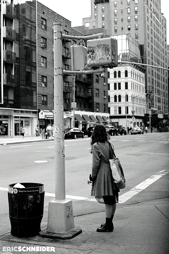 Guy Photographing Girl Standing On Corner.
