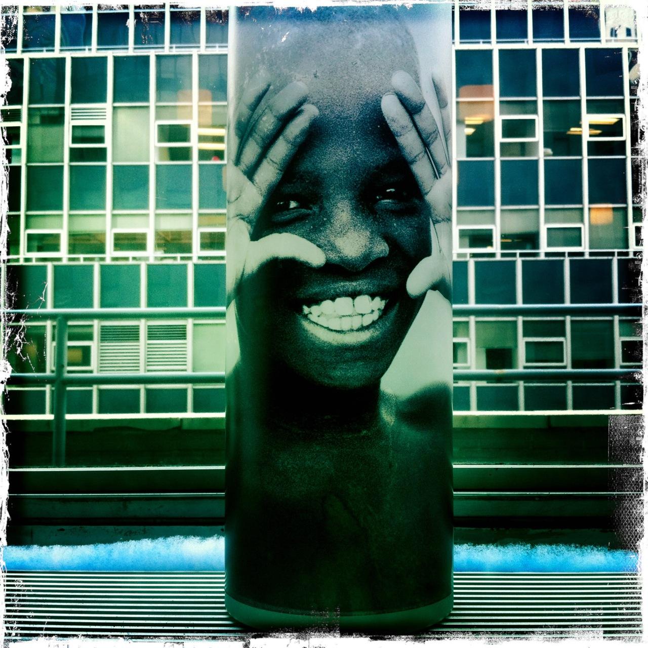 Smiling boy on votive.