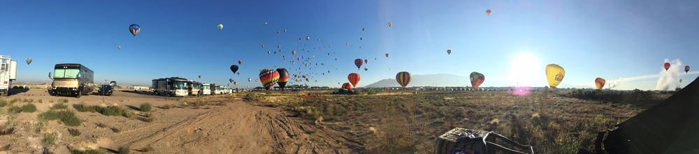 Over 500 balloons ascend as 100,000 spectators watch from the field!