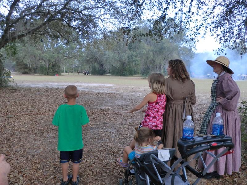 The kids watching the Civil War Battle.