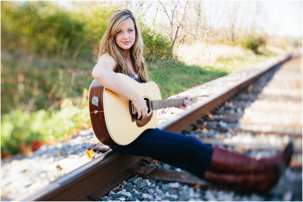 Shelby Searcy singing with a guitar - Cleveland Senior Portraits