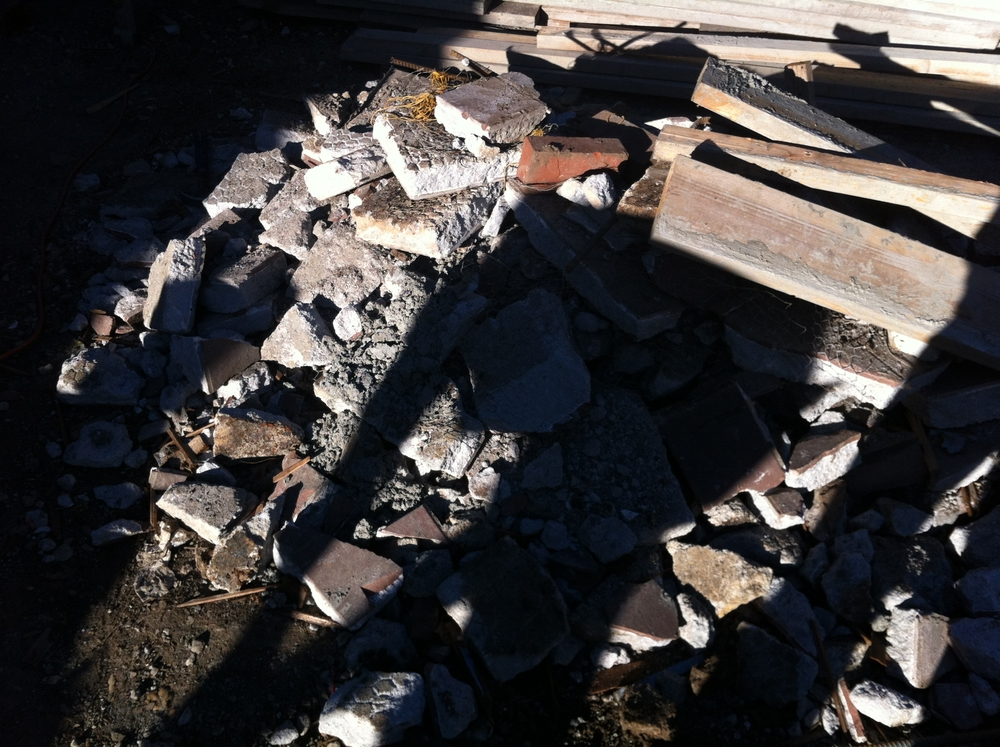 "This is the rubble pile from the old second story deck. It had something like 4"" of mortar creating a crazy heavy deck."