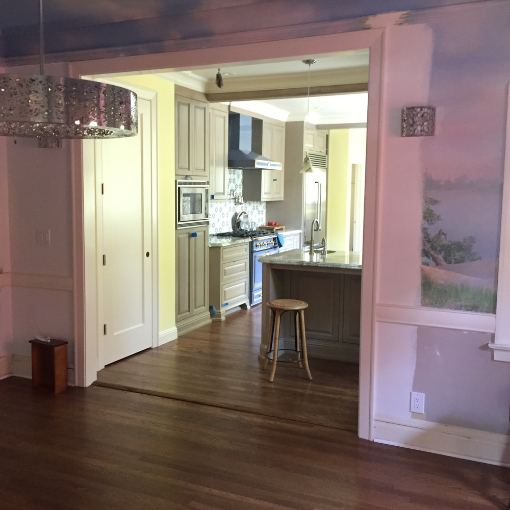 This view from the existing Dining Room to the new Kitchen is an amazing transformation from the old dark hallway.