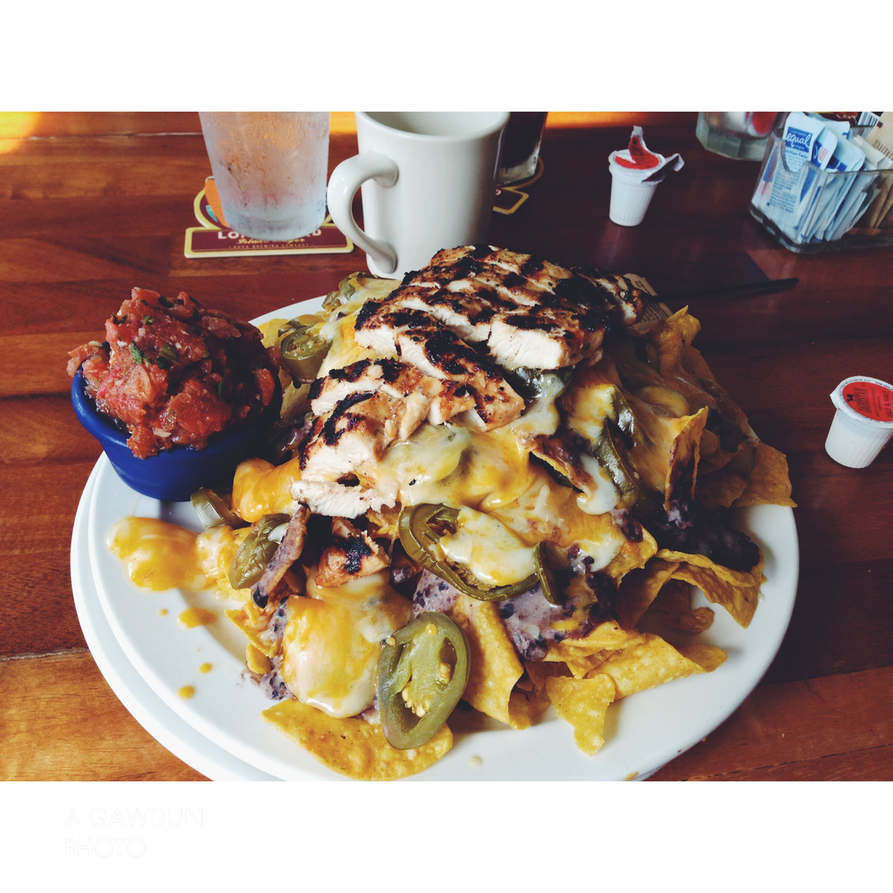 And when on vacation it's always permitted to eat Kauai chicken nachos.  The plate pretty much looked like this when I was full.  It was so intense!