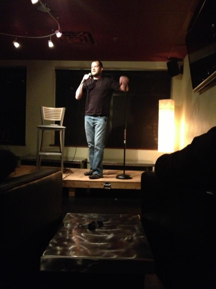 On stage at Tickle Me Tryouts open mic