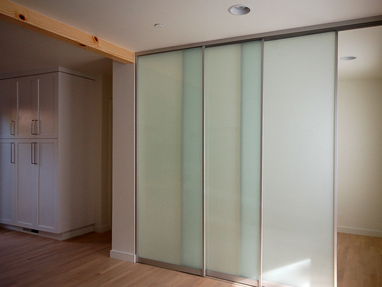 Defining space sliding door systems myd blog moss yaw for Sliding glass wall panels