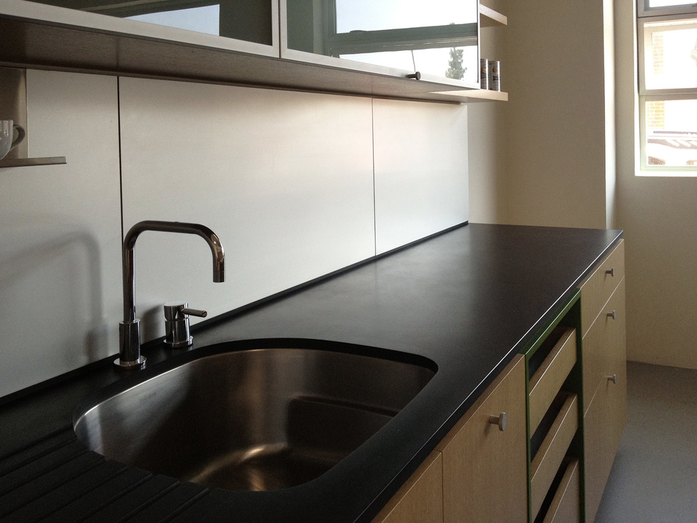 paperstone countertop + metal backsplash