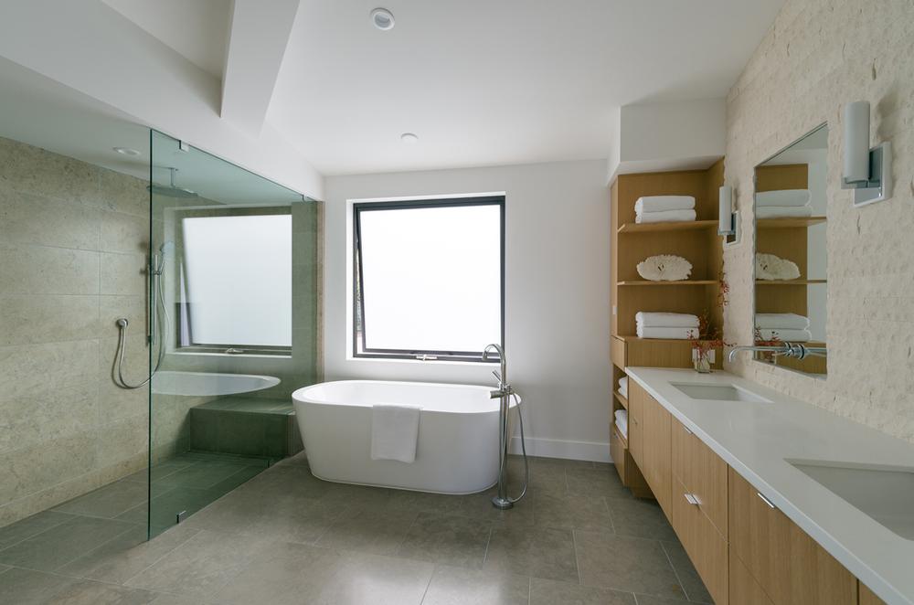 floating tub at custom shower / master bath