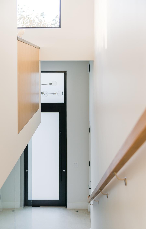oversized pivot door / entry stair
