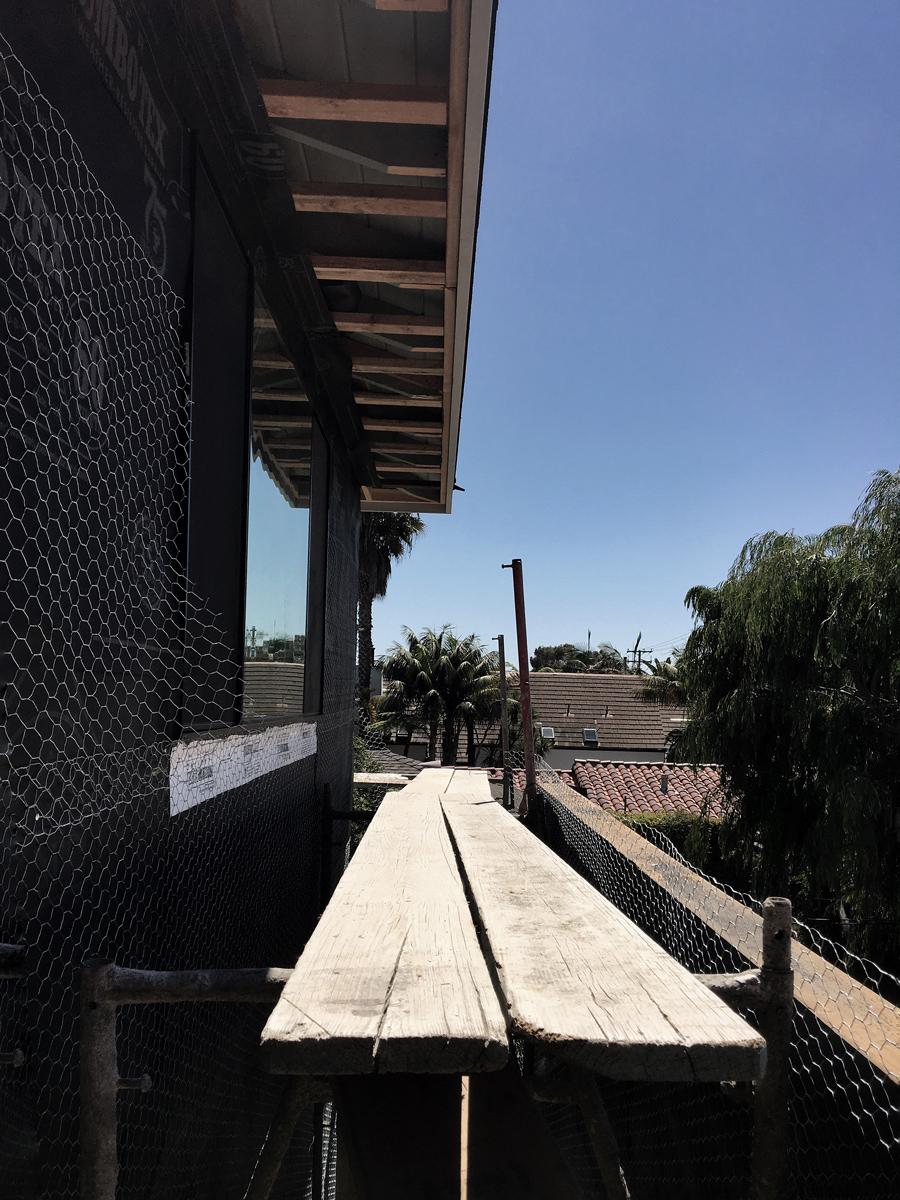 stucco at upper level