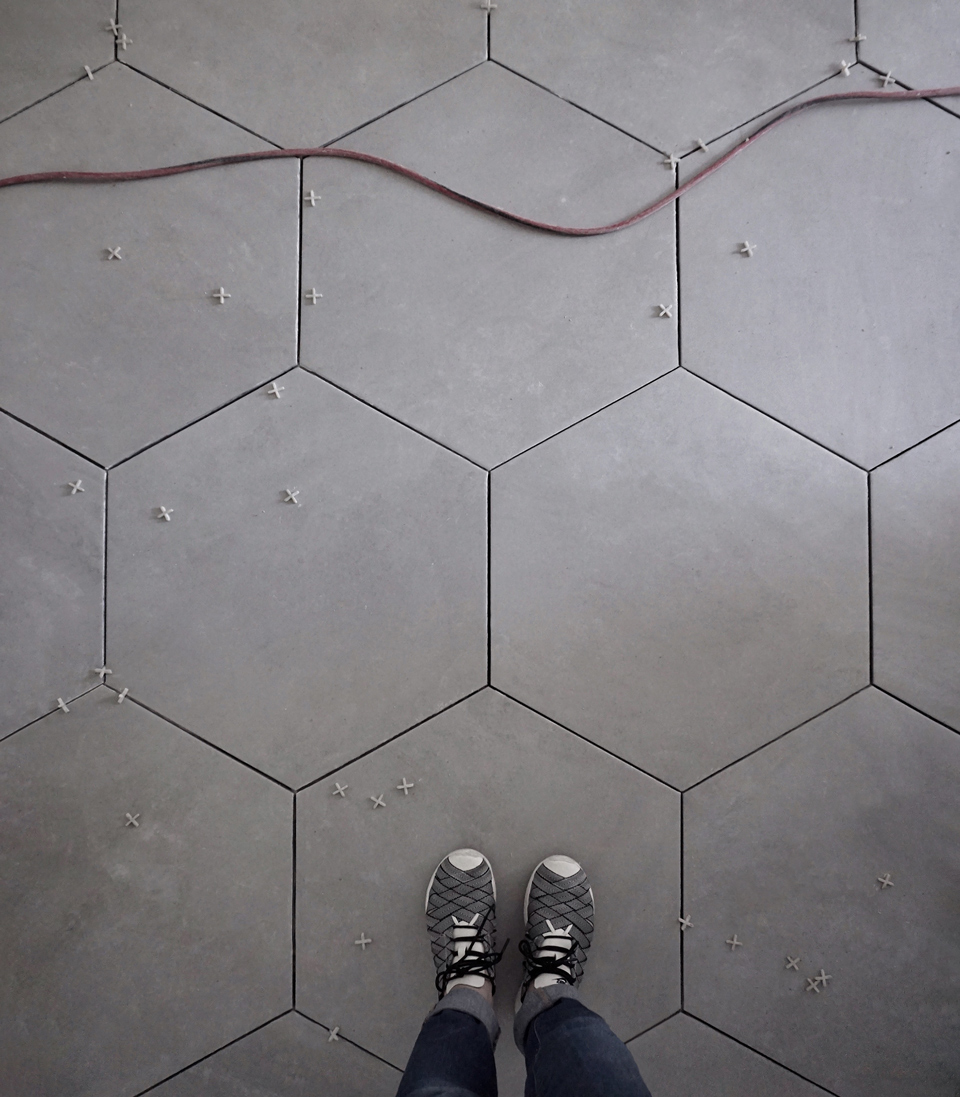 grey hex geometry / large format porcelain tile at downstairs addition