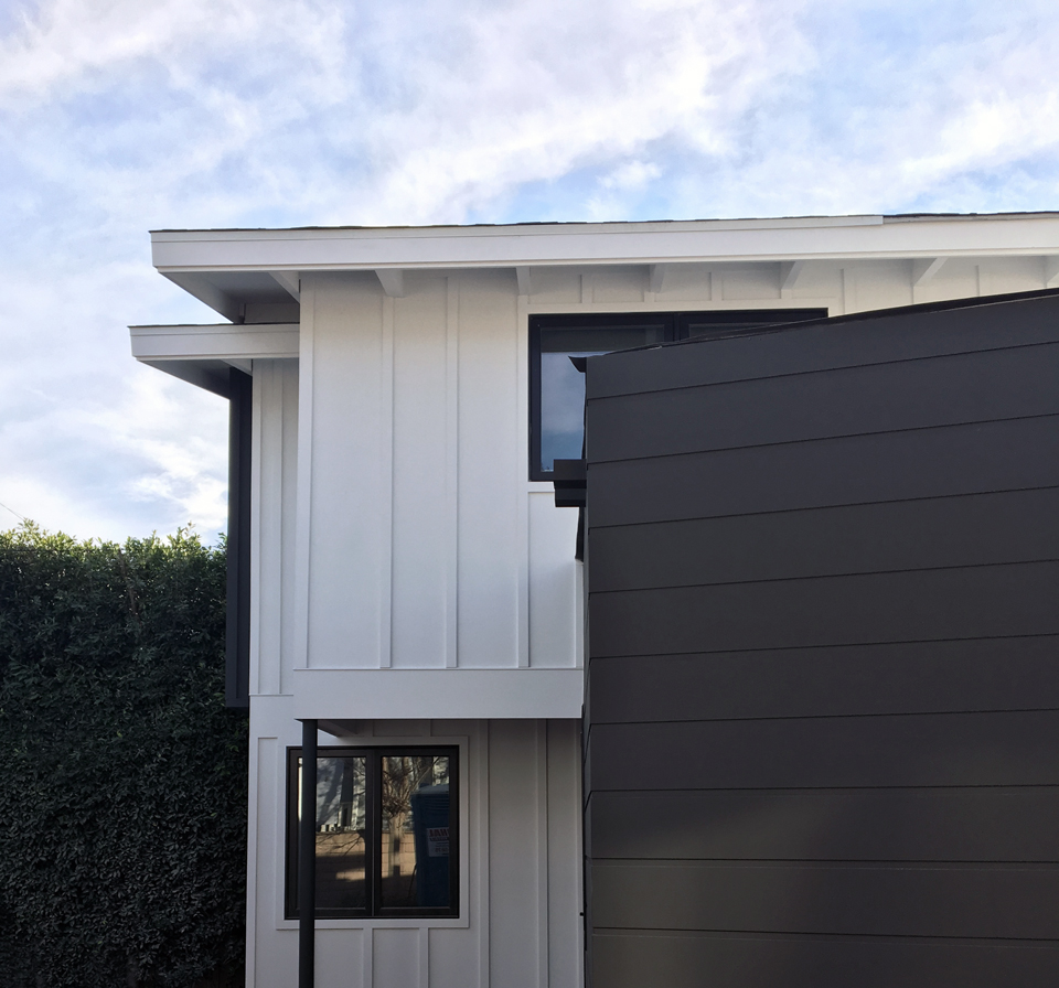 black + white siding at structural steel
