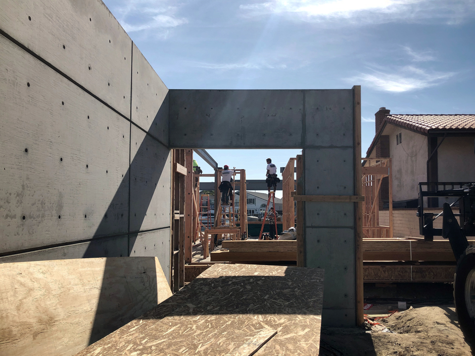 concrete wall at entry + first floor framing