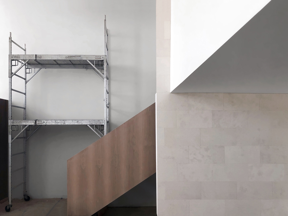 floating stair at limestone wall - under construction in hunting