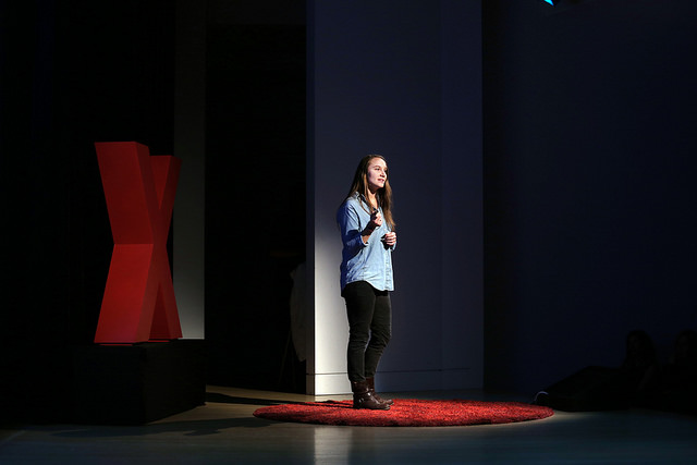 "Sarah Menzies on the TEDxSacramento stage at ""This Changes Everything: Women"" on December 12, 2015."