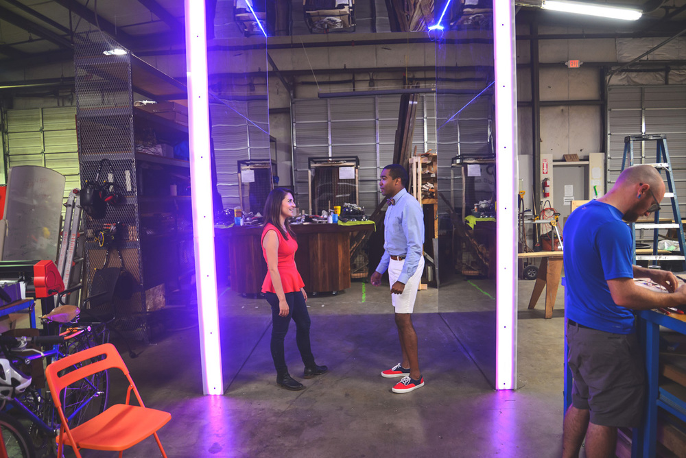 [Tre Borden, Project Manager of PORTAL, and Kimberly Garza, Designer of PORTAL, standing in the structure.] (photo courtesy of City Scout Magazine)