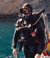 Brad Doane prepares to dive a modified Biomarine Mark 15 rebreather.  Photo by Mike deGruy