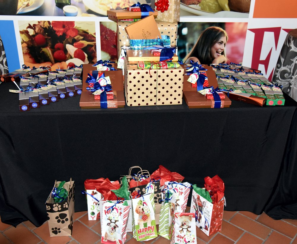 We have gifts for our employees, their guests, their kids and pets, and our bosses.