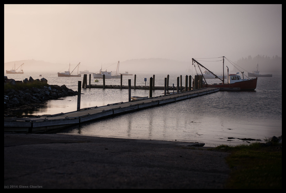 Summer sunset with fog that grades to colors to shades of gray -- Leica M240, Lux 50 1,4