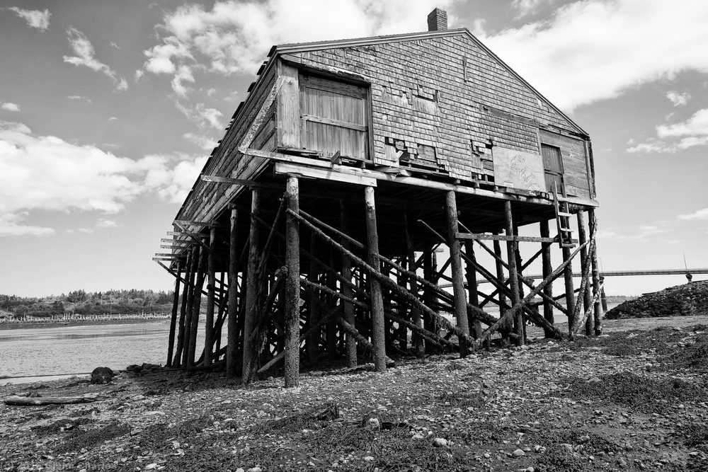 Super low tides reveal the decaying structure of a Down East Maine smoke house A7rii/21 Loxia
