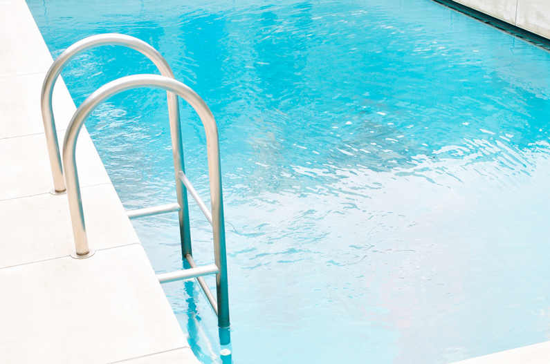 Remove the ladders in a pool-to-pond conversion and fill in the screw holes with putty.